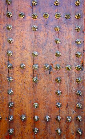 Church door wooden detail in Spain Castile La Mancha