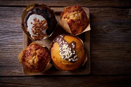 Chocolate muffins on wooden board table low key