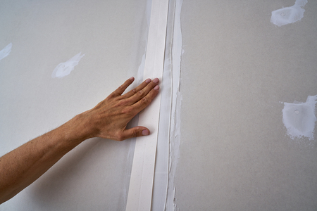 Laminated plasterboard plastering join tape DIY detail Фото со стока