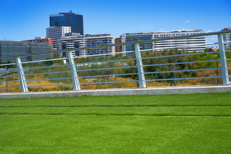 Valencia train railway with green turf grass and railing at spain 写真素材