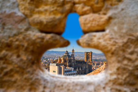 Alhambra window of Granada Cathedral photo illustration Stock Photo
