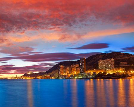 Alicante skyline at sunset from Albufereta beach in Spain Costa Blanca Фото со стока - 115794937