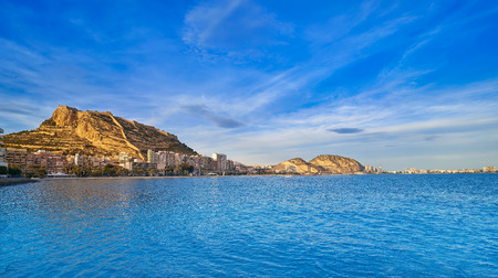 Alicante skyline at sunset from Postiguet beach in spain Фото со стока - 115795017