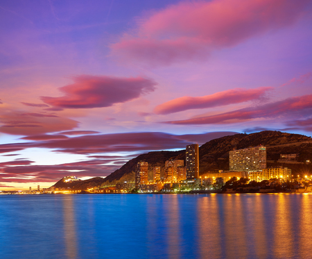 Alicante skyline at sunset from Albufereta beach in Spain Costa Blanca Фото со стока - 115795313