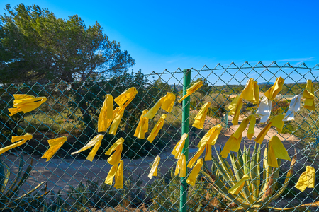 Yellow ribbon ties in Catalonia protest against political prisoners sign