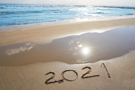 year 2021 numbers spell written on beach sand shore