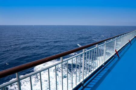 Ferry cruise railing in a blue Mediterranean sea ocean
