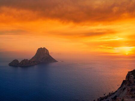 Es Vedra islet sunset in Sant Josep of Balearic Islands
