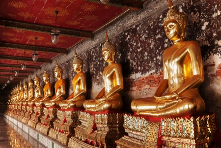 Golden Buddha at corridor, Wat Suthat temple, Thailand photo