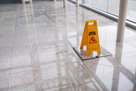 wet floor sign on lobby floor Stok Fotoğraf