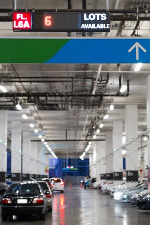 new car lots: indoor cars parking with electronic board show number of available lots Stock Photo