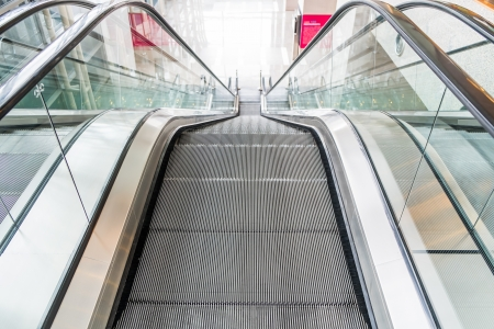 Empty escalator perspective from up to down photo