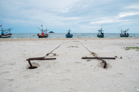 Anchors on the beach photo