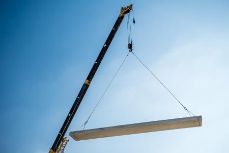 concrete block: Crane lifting cement block Stock Photo