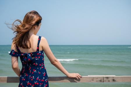 Back of a girl looking into the sea Фото со стока