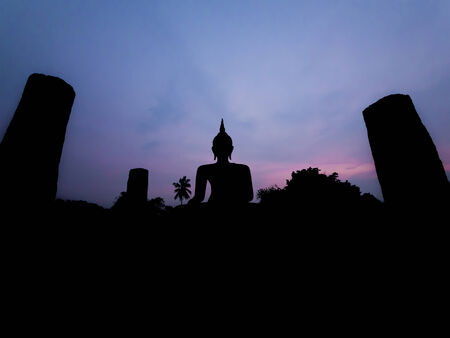 Silhouette buddha image at twilight at Wat Mahathat Sukhothai Thailand