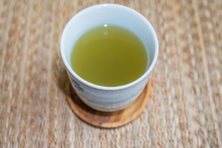 A cup of hot green tea Фото со стока