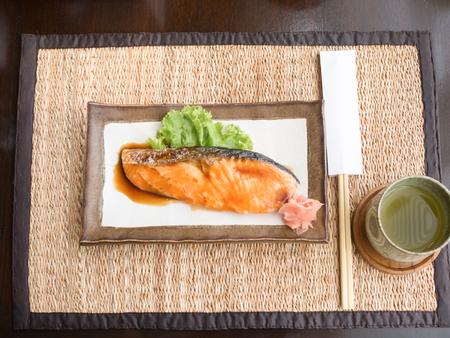 Salmon fried with Japanese sauce photo