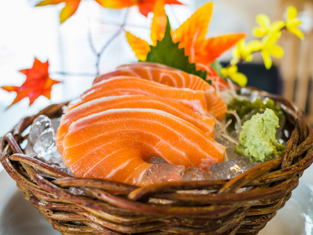 A dish of salmon sashimi served on ice