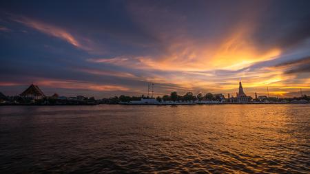 Chao Praya river (Bangkok, Thailand) at Twilight with Wat Arun and Wat Kalayanamitr in the background.