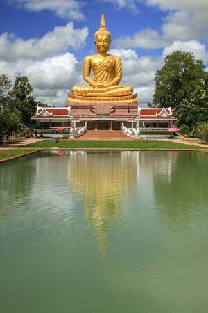 Statue of Big Buddha image water reflection.