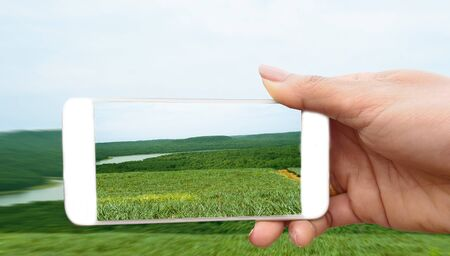 Woman make photo on smartphone, using phone in hand, travel nature river and mountain, Close up of womens hands holding mobilephone with  copy space screen.