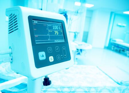 Blurry image : Bedside automatic blood pressure monitor and automatic patient monitor in hospital emergency room
