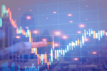 Double exposure of graph Stock market exchange on blurred photo of city scenery background, business trading, construction and technology concept.