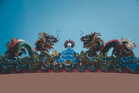 Chinese style dragon statue Chinese art style Temple Roof in shrines or temples Фото со стока