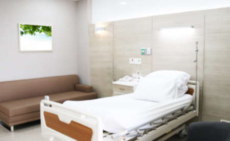 Blurred, soft images decorate the patient's bed. The work of the nursing staff in the new hospital building.Abstract blur hospital room interior for background
