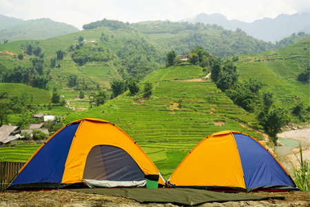 Tourist dome tent camping  in forest camping on mountain background