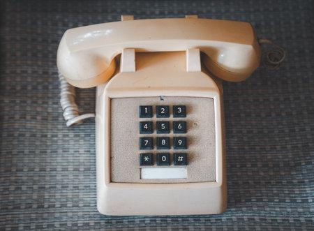Top views Retro rotary telephone on wood table