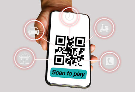 QR code pay,Closeup of a hand holding smartphone and scanning qr code. Man hand paying with qr code.