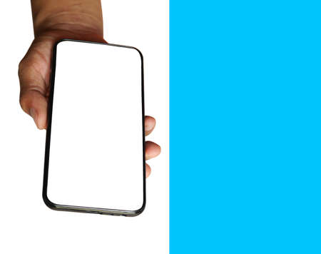 Man hand holding black smartphone isolated on white and blue background