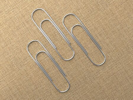 Paperclips laying on canvas