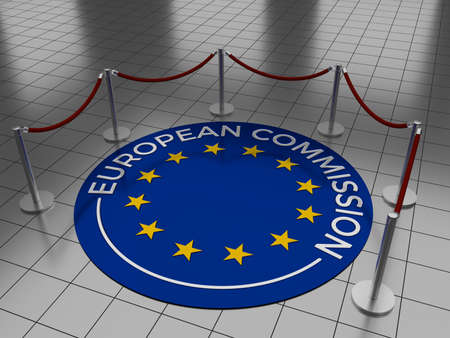 Round illustration laying on a tiled floor with the text European Commission including the European Union (EU) stars. Stock Photo