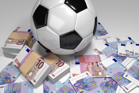 Football combined with 10 and 20 euro bills. Фото со стока