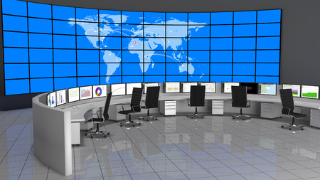 Security Operations Center containing computers desks and a large screen containing the world map. Stock Photo