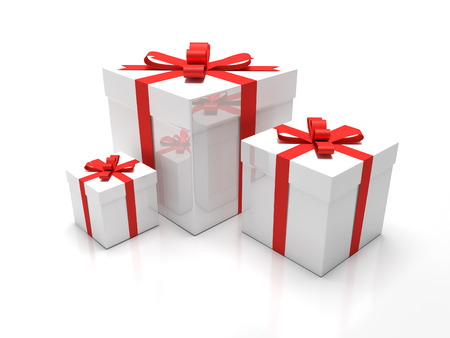 A set of three white gift boxes with red ribbon around it. Presents for christmas time or valentines day.