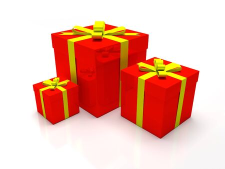 A set of three red gift boxes with yellow ribbon around it. Presents for christmas time or valentines day. Stock Photo