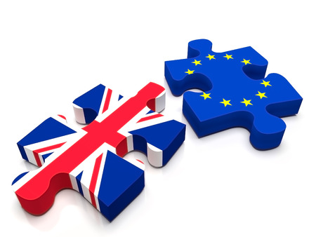 2 puzzle pieces: One containing the British Flag and the other the European Union / EU flag. Is UK leaving Europe with the BREXIT?