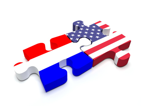 Puzzle pieces connect a piece containing the Dutch flag and the US flag. Stock Photo - 40559295