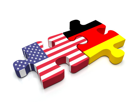 international crisis: Puzzle pieces connect a piece containing the US flag and the German  flag.