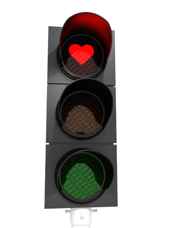 A traffic light showing a red heart in the red light.