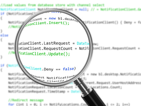 Magnifying Glass focussed on source code Stock Photo
