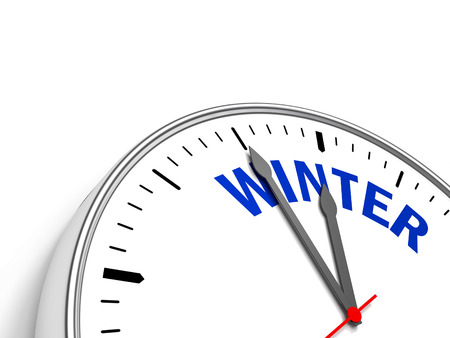 Clock containing the text Winter. Stock Photo