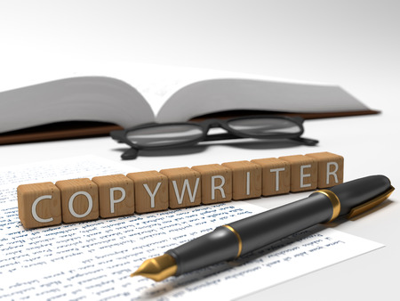 Copywriter -  - dices containing the word copywriter, a book, glasses and a fauntain pen. Stock Photo