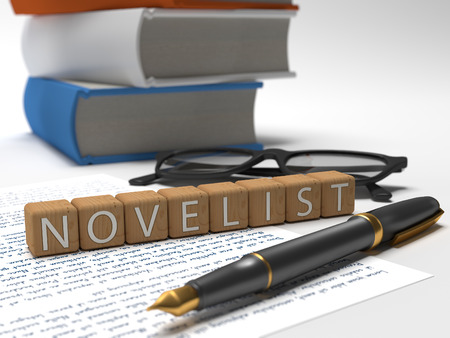 Novelist - dices containing the word novelist, a book, glasses and a fauntain pen. Stock Photo