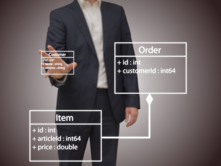 software: Software Architect - Software architect designing an UML model on a screen. Stock Photo