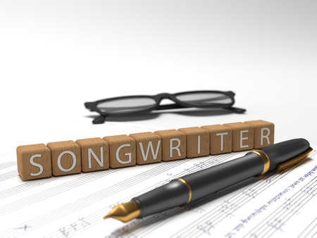 Songwriter - dices containing the word songwriter, a book, glasses and a fauntain pen. Stock Photo